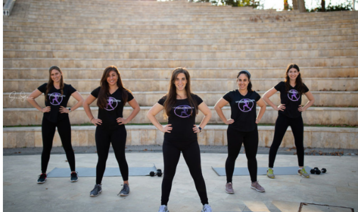 Esther Taub of Esther Taub Fitness standing with her other trainers