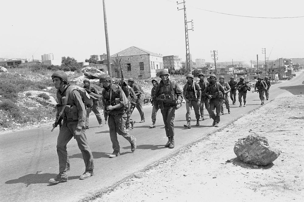 Israeli forces walking through Lebanon during the First Lebanon War, 1982.