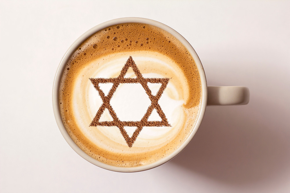 A cup of coffee with an Jewish star on top
