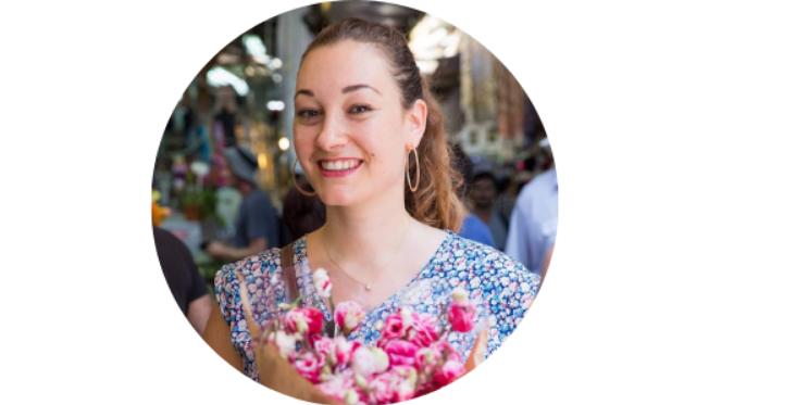 Olah Yudith Guttman holding a bouquet of flowers