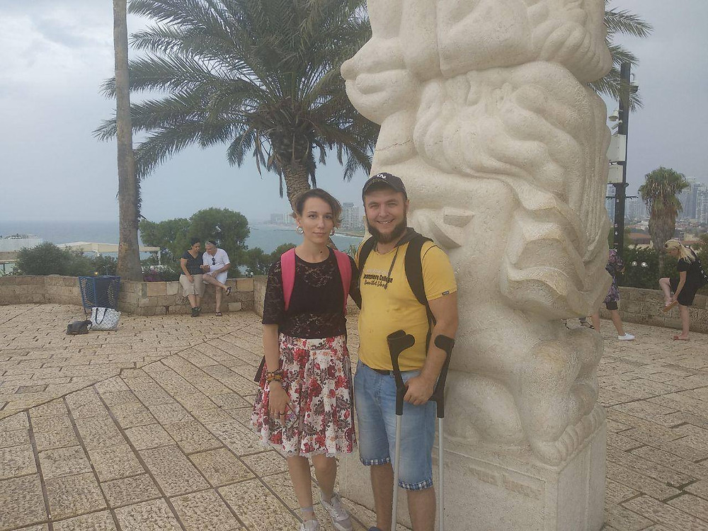 Oleh Andrew Pylypenko standing next to a sculpture with his wife