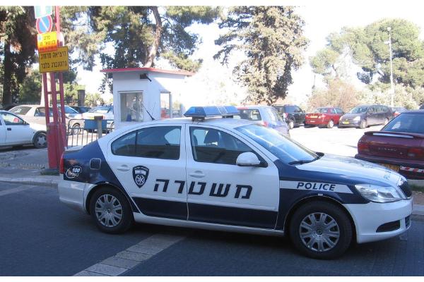An Israeli cop car leaving a parking lot