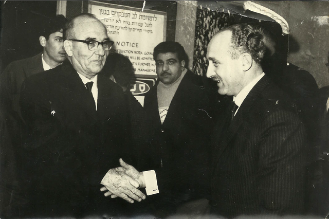 Yaakov Uri shaking hands with Prime Minister Levy Eshkol