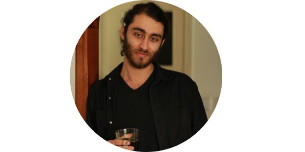 Peter Shamah holding a glass