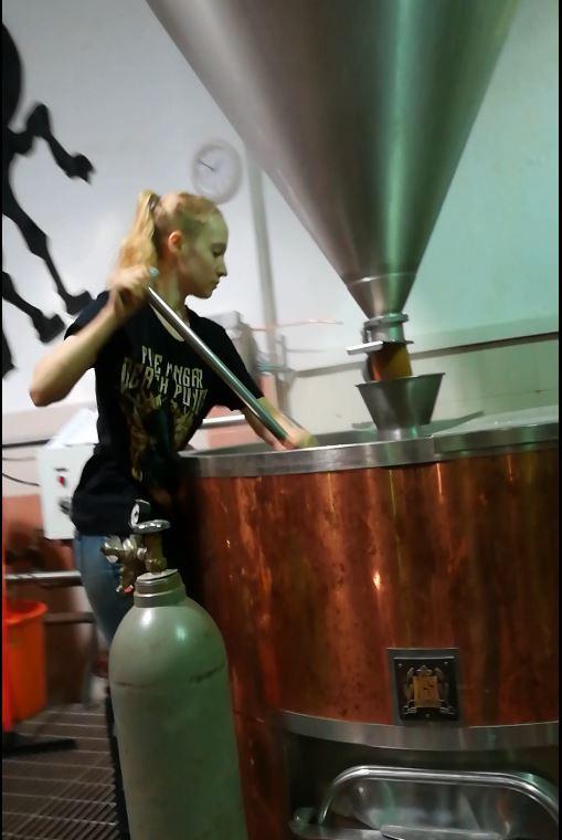 Oleh Yonina Sakols Friedman mixing grain in a brewery