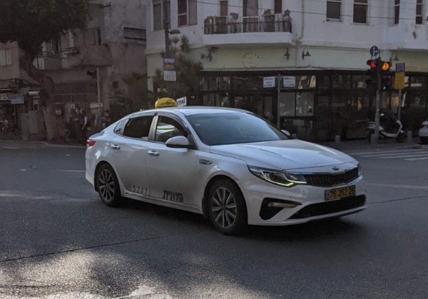 An Israeli taxi car in the middle of an intersection