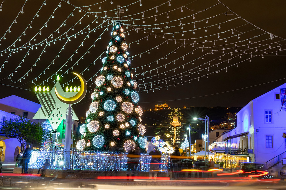 A large Christmas tree lit up in Haifa during the winter