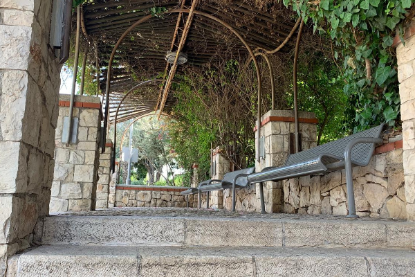 A covered sitting area in Yemin Moshe