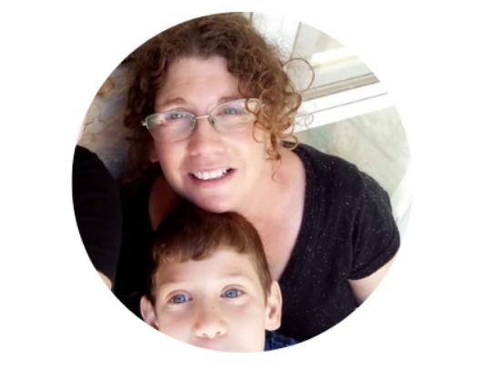 Olah Lauren Adilev with one of her children on her lap