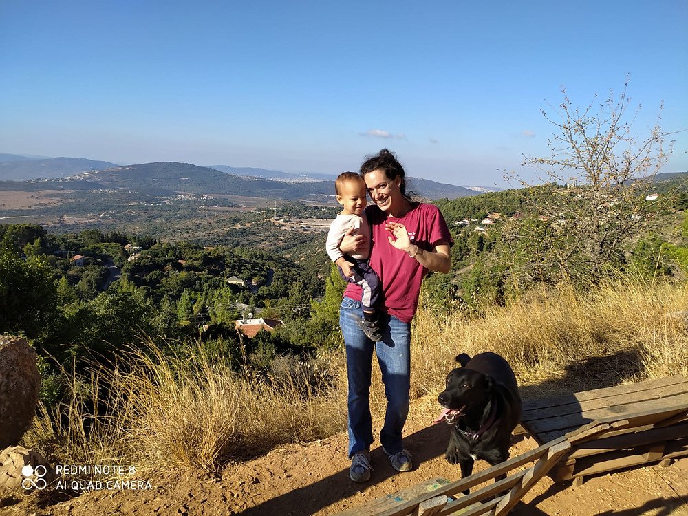 #Meet_the_Oleh, Maddie De Silva's husband holding their son and their black dog at their feet