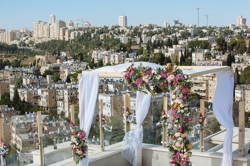A Jewish wedding huppah on a balcony overlooking Jerusalem