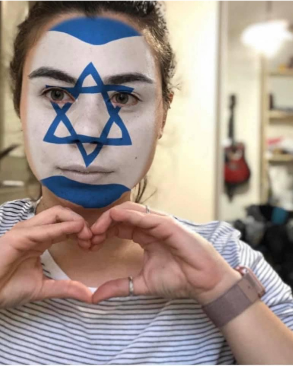 Israeli author, Gili Meshulam with an Israeli flag painted on her face