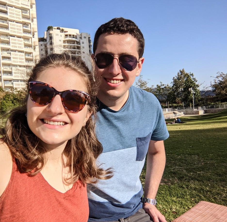 Amy Vogel taking a selfie outside with her boyfriend