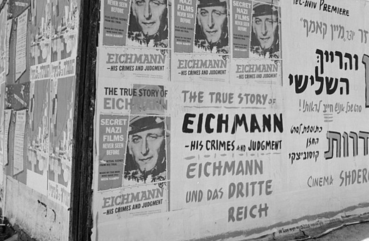A wall covered in posters about the trial of Adolf Eichmann in Tel Aviv