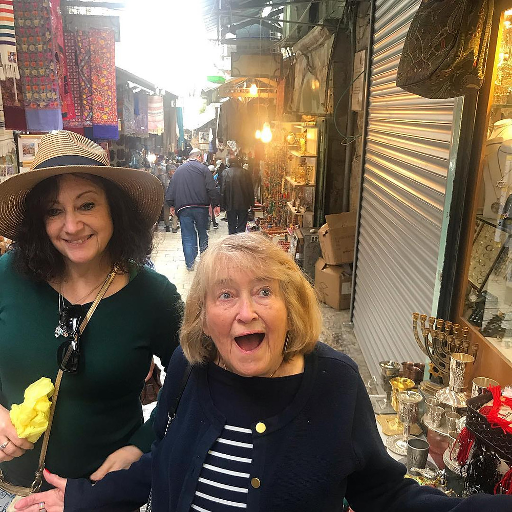 Barabara Gordon at the shuk in the Jerusalem Old City standing next to her daughter