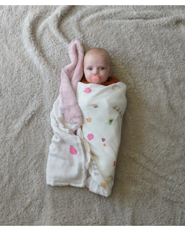 Baby wrapped in blanket sold by Tiny & Mighty