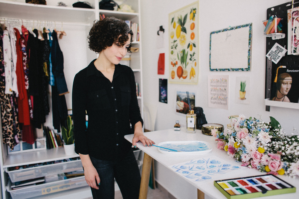 Malka Klein standing over her work table in her studio