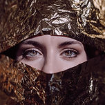 woman-behind-gold-paper-2388647.jpg
