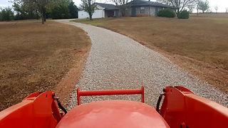 Driveway repair maintenance with new gravel