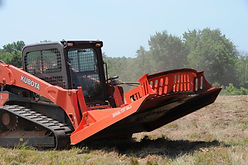 Forestry mulching attachment for clearing land