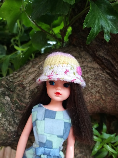 Cloche hat with button detail