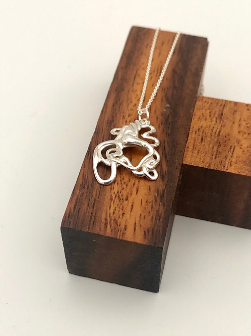 """The """"Squiggle 1"""" Silver Pendant."""