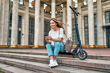 charming-girl-student-sits-steps-scooter