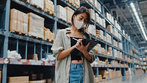 young-asian-businesswoman-manager-wearing-face-mask-warehouse-using-digital-tablet-checkin
