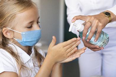 little-girl-disinfecting-her-hands.jpg
