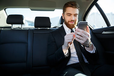 man-suit-looking-mobile-phone-his-hand.j