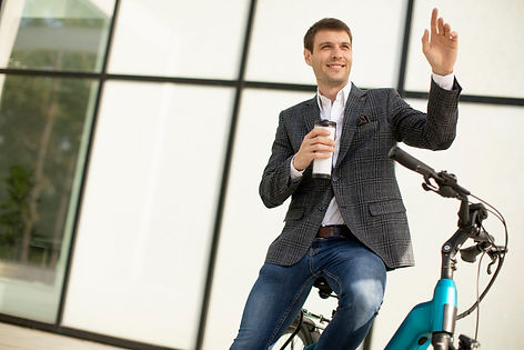handsome-young-businessman-ebike-with-takeaway-coffee-cup.jpg