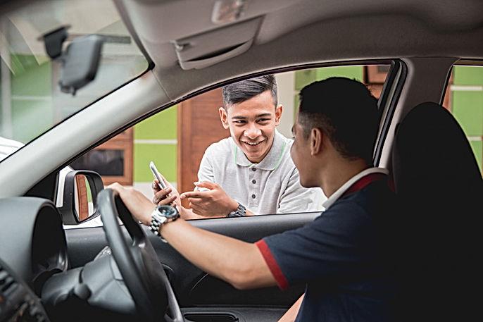 customer-ordering-taxi-via-online-apps.j