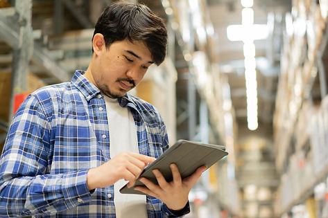 middle-eastern-auditor-man-look-hold-digital-tablet-check-order-storage-distribution.jpg