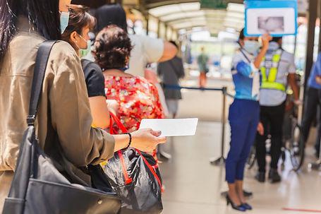 passengers-medical-mask-holding-boarding-pass-queueing-departure.jpg