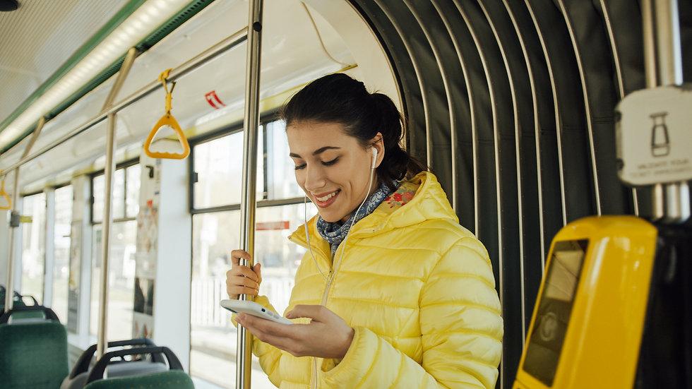 happy-female-passenger-listening-music-smartphone-public-transportation.jpg
