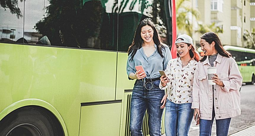 happy-asian-friends-using-smartphones-bu