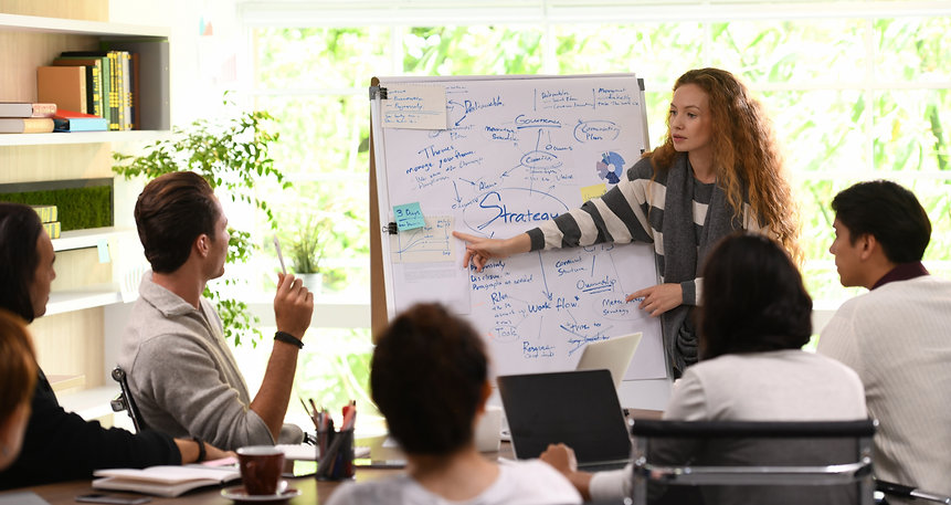 young-business-woman-giving-presentation