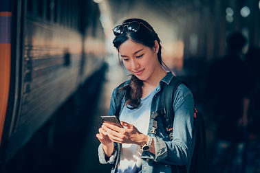 asian-woman-traveling-with-mobile-phone.