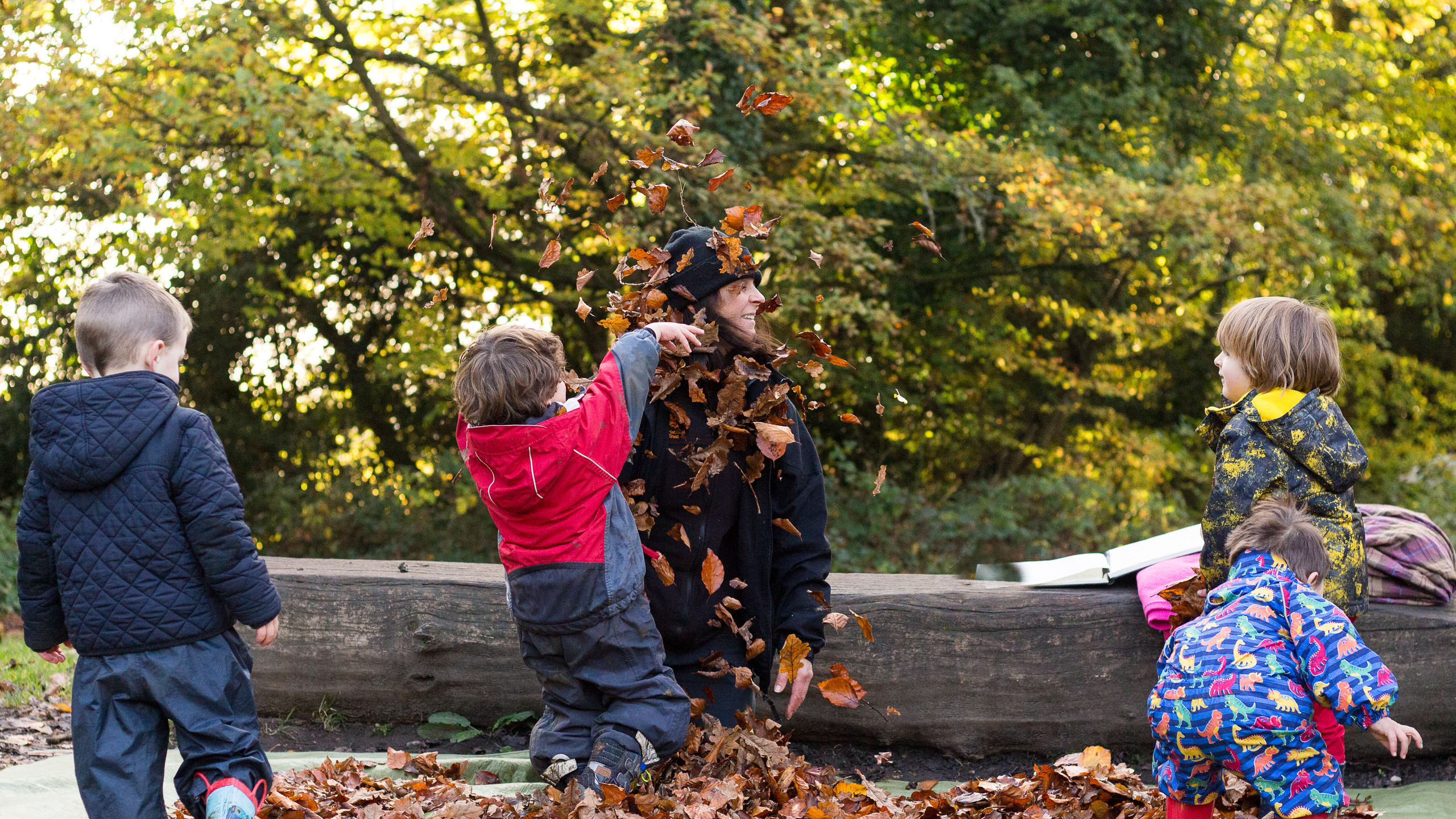 Children on Boxhill throwing leaves
