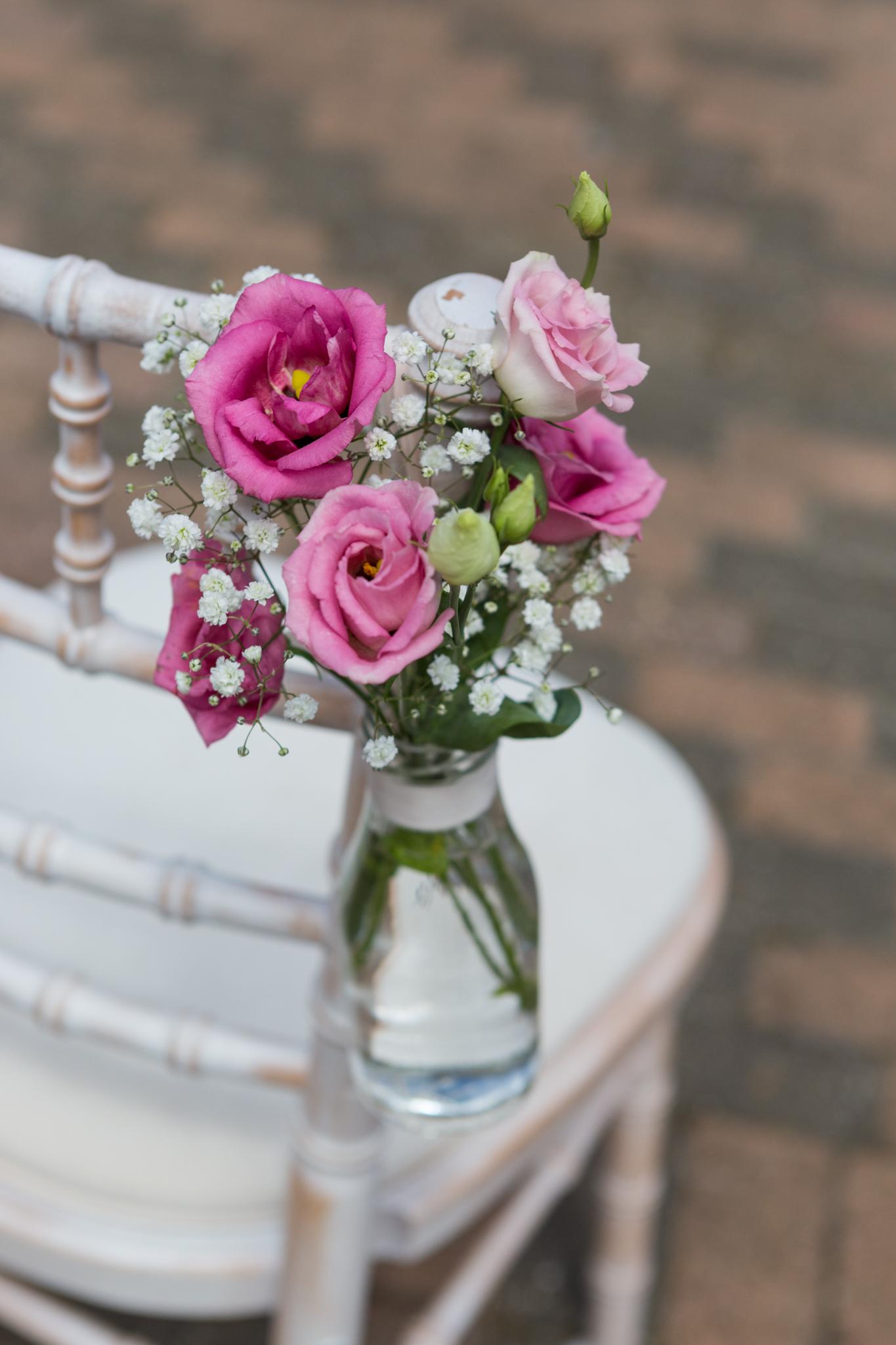Chair_flower_ideas_Old_Greens_Barn_Newdigate_Surrey_Wedding_Photographer_Rachel_Thornhill_Photograph