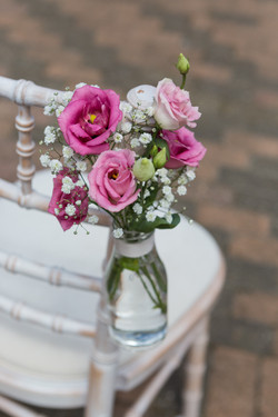 Chair_flower_ideas_Old_Greens_Barn_Newdigate_Surrey_Wedding_Photographer_Rachel_Thornhill_Photograph