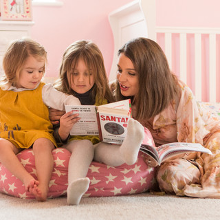 Mother and Daughters reading at home