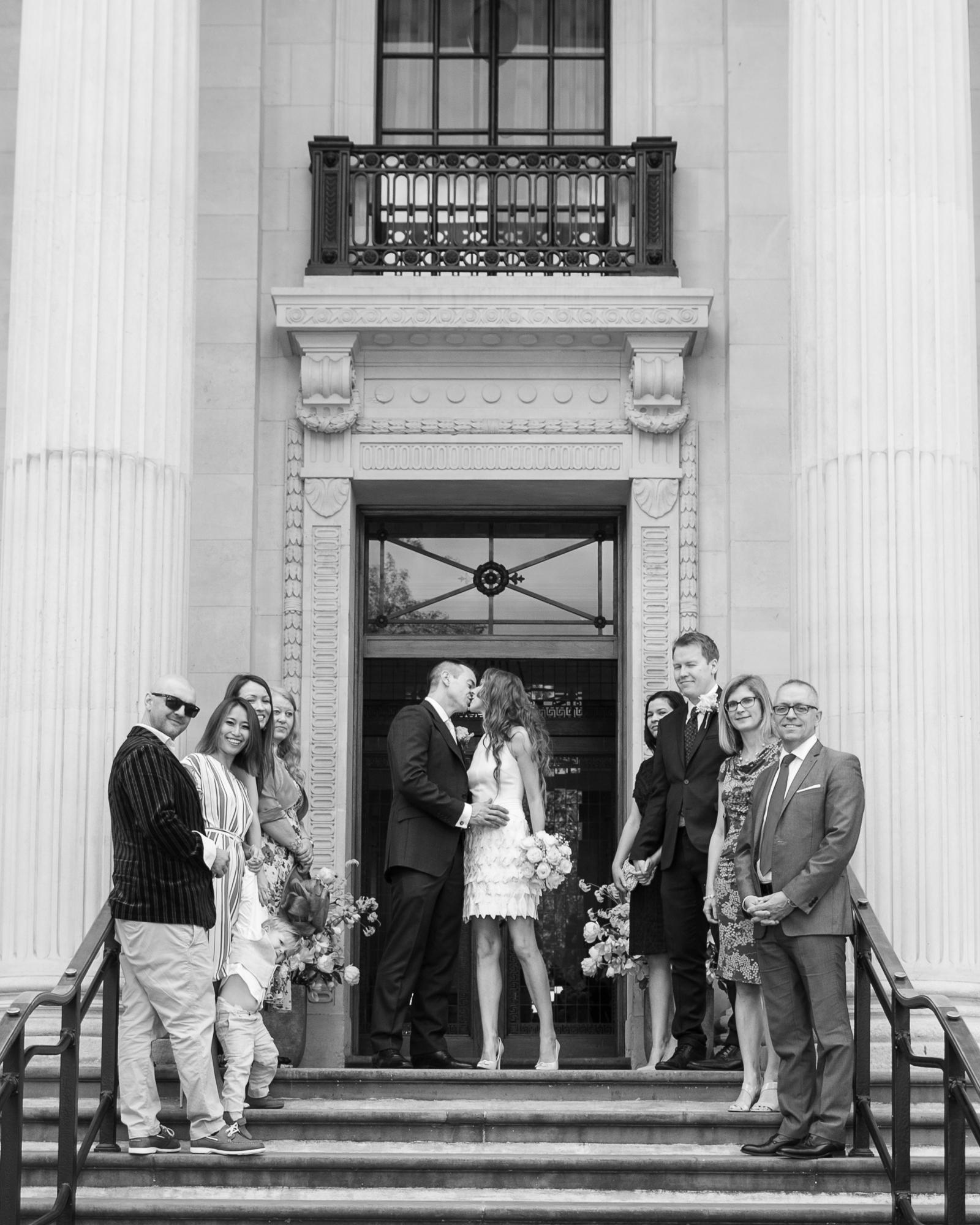 Kiss_the_Bride_Marylebone_Registry_Office_London_Wedding_Group_Natural_Fun_Rachel_Thornhill_Photogra