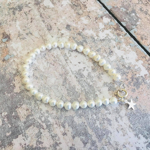 Fresh water pearls (5mm) finished with sterling silver clasp and star charm