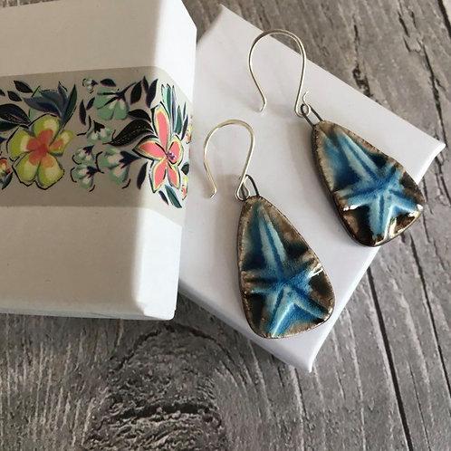 Starfish ceramic drop earrings.