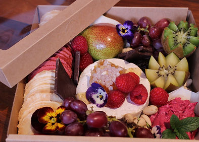 Mini Grazing box with Brie cheese, honeycomb, crackers, dips, chocolate, fresh seasonal fruits and edible flowers