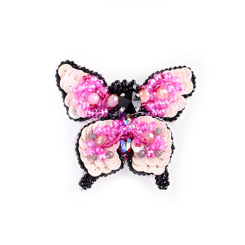 Ružičasti broš