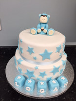 Blue teddy with stars and blocks