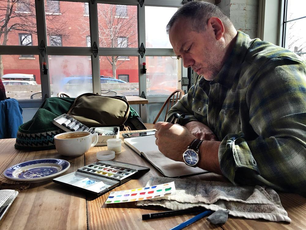 Marc-André Pauzé dessinant pendant un voyage (urban sketching)