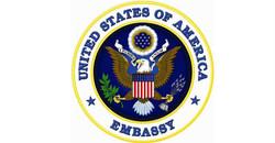 Embajada-Americana-en-Santo-Domingo-Raccoon-Knows logo
